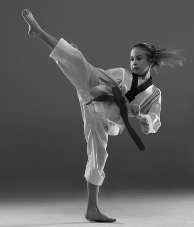 00 girl kick karate grey 385x450